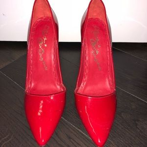 Alice and Olivia red patent leather pumps